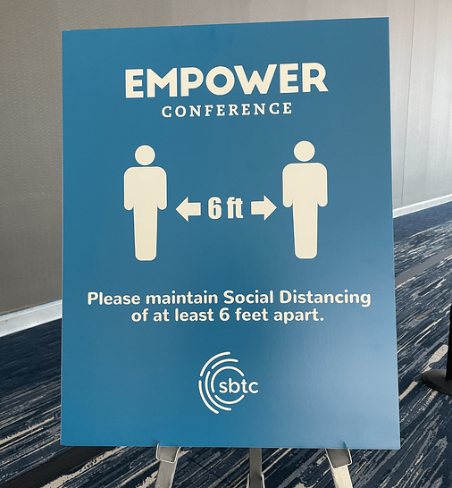 returning to inperson events safely-empower conference 6 feet apart signage